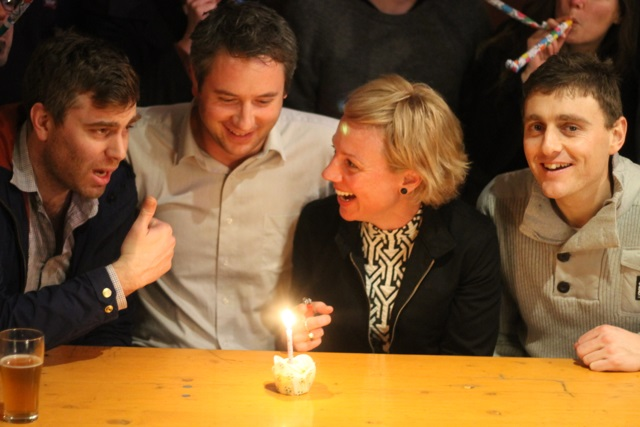 James, Linden, Nina and Andrew blow out the candle on a great first year.